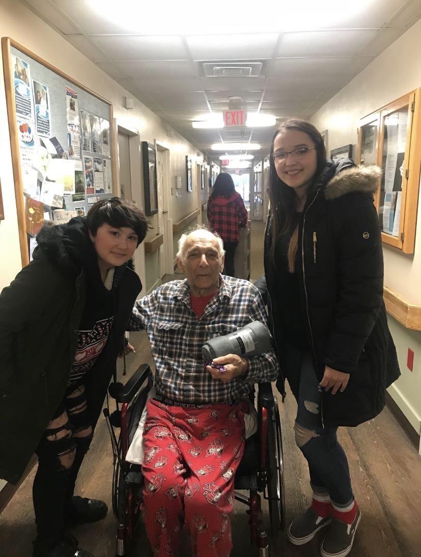 Junior Deondra Lohrentz-Pamonicutt and freshman Ashton Moses with their adopted grandpa.