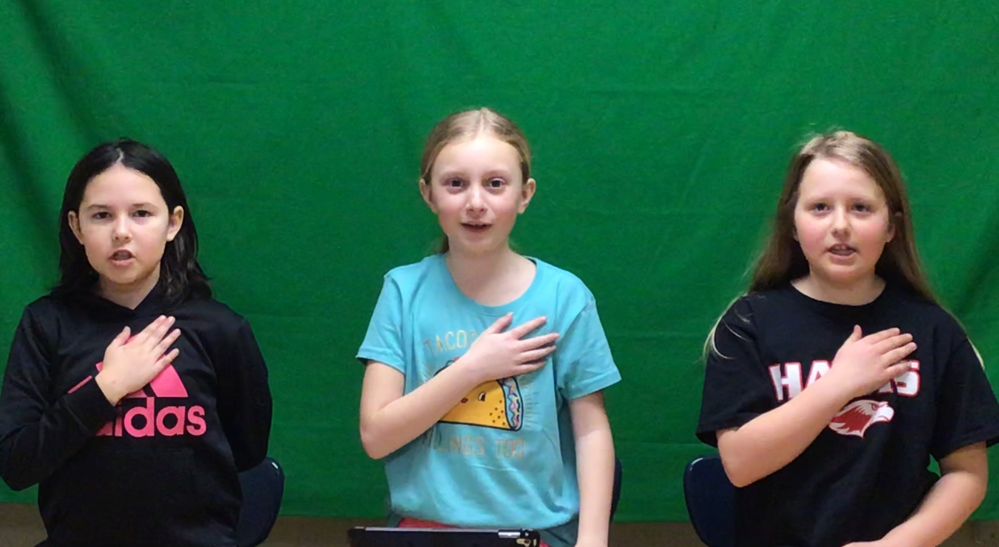 Students at Brener doing the pledge during the announcements.