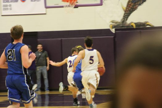 Senior Aaron Prindle runs down the court during the game against Odessa.