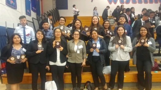 FBLA members holding the awards presented to their great organization.