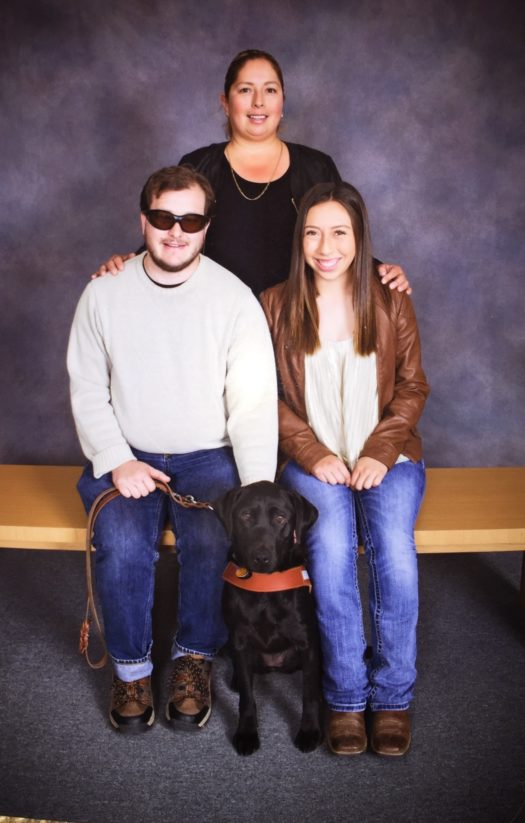 Ariadna Romero sitting next to Jordan Fitzpatrick and Felice the dog.