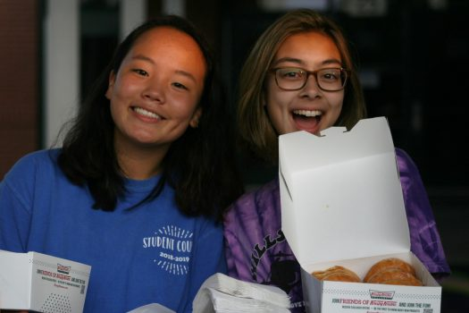 Student Council Representatives Michelle Lee (10) & Susie Browder (10) hand out donuts at canopy.