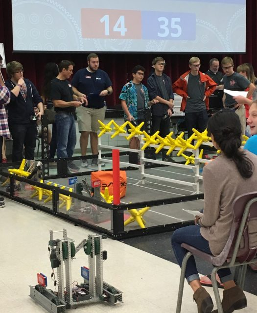 Vex Robotics students from the surrounding area schools watch a duel.