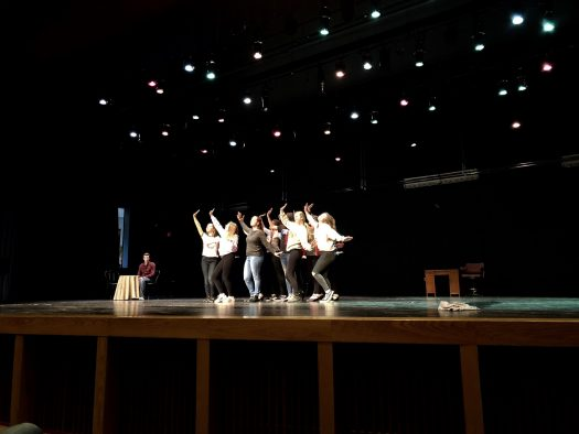 The cast practices a scene in preparation for New Berlin West's upcoming performance (Feb 9-11).