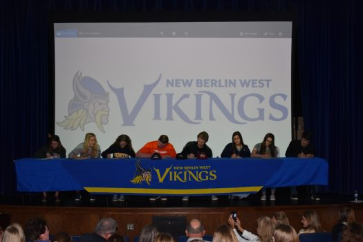 Eight seniors sign their letters of intent to compete in collegiate athletics.