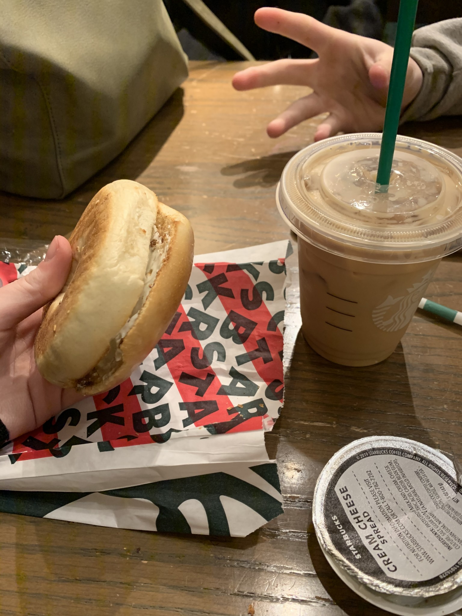 Bagel with cream cheese and iced coffee from Starbucks