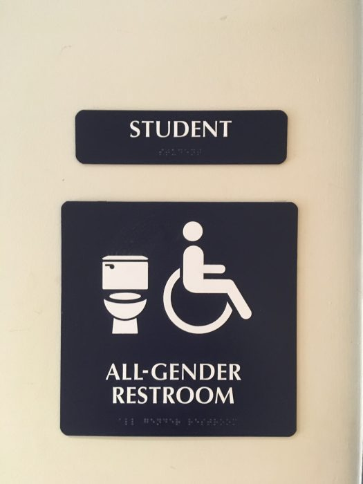 Gender-neutral bathroom sign in the guidance area.