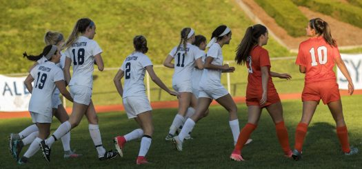 Girls' Soccer celebrates their victory on Senior Night.