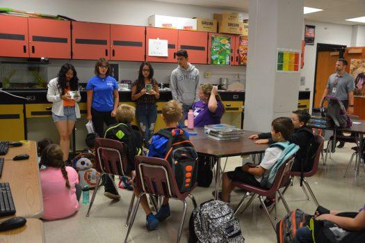 Freshmen Ericka Carias, Natalia Valenzuela and Alejandro Diaz-Sanchez teach third graders.