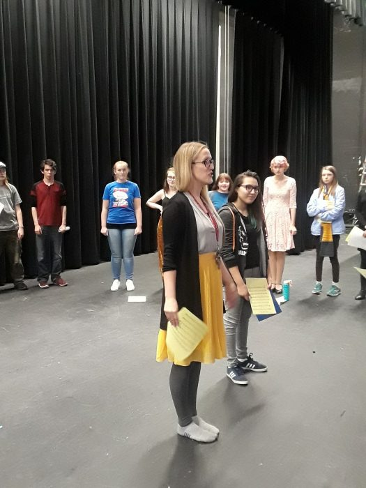 Musical Director Lauren Wasser gives instructions to students during auditions