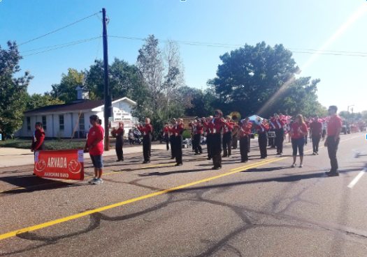 The Arvada Marching Band leads the rest of the staff and students in the Harvest Festival Parade