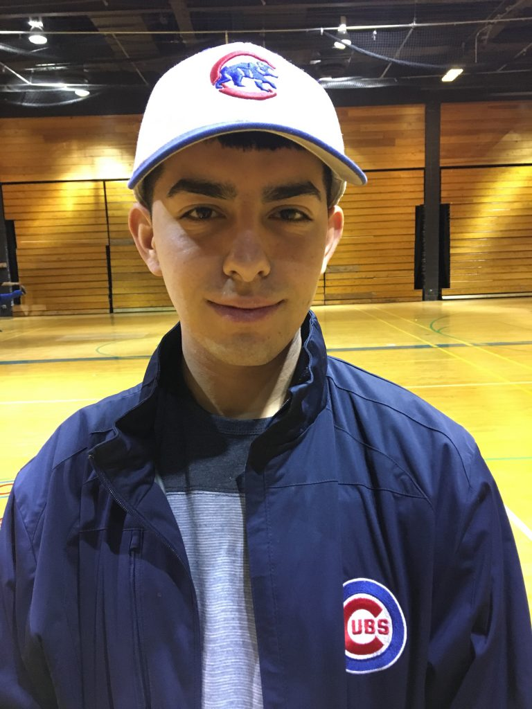 Montenegro shows off his Cubs gear in the Curie gym.