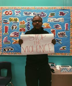Norwood shares an anti-violence sign.