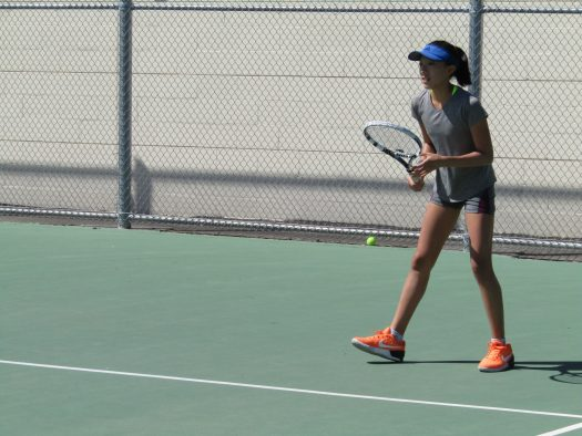 Freshman Joanna Yi prepares to return a serve.