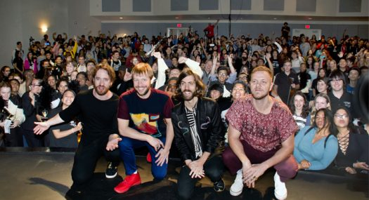 Imagine Dragons band members pose in front of starstruck audience in Clark theater.