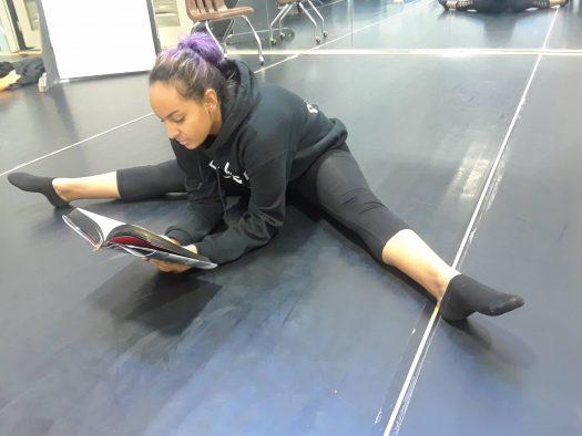 Rayven Belisle, 11, of Dance 2 reads a book in the dance studio