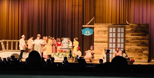Students performing a scene from Beauty and the Beast during the feeder school preview on Feb. 28.