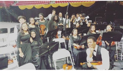 PHS' 2016-2017 orchestra poses for a picture before a performance.