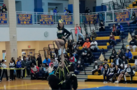 PHS Cheer Elite shows their sportsmanship during the 2018 PG County Championships.