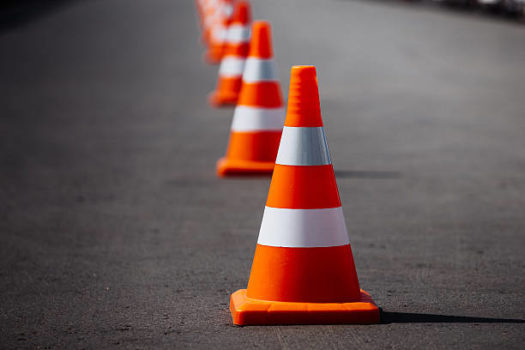 Oranges cones and barriers now help guide traffic during morning drop-off.