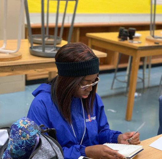 """Sophomore Precious Agary writes during a free-writing activity in """"Her Truth."""""""