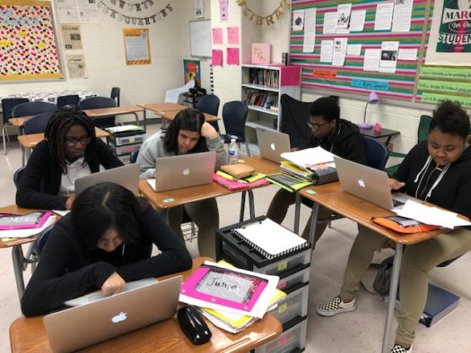 Freshman Phabean Williams sits among a group of girls in Ms. Guevara's Honors ELA 9 class.