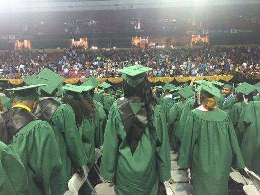 Flower High school graduates wearing all green after policy.