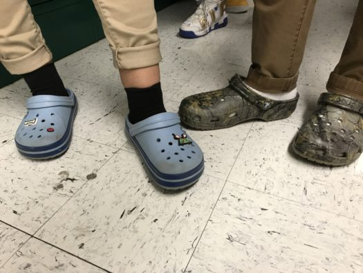 Some students can still be seen wearing Crocs despite administration's push to ban them.