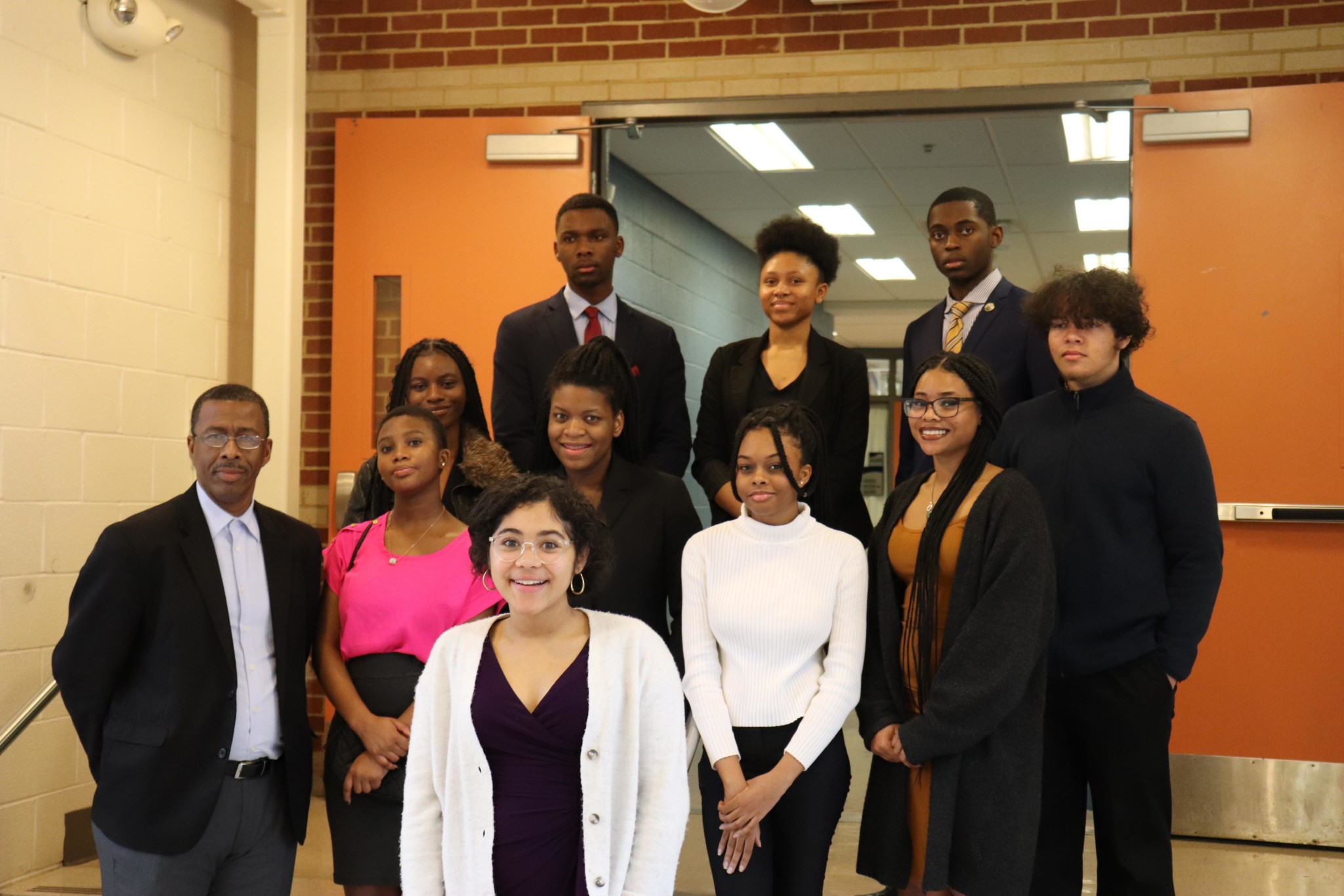 The Mock Trial team, with sponsor Mr. Blake, boasts another undefeated season.