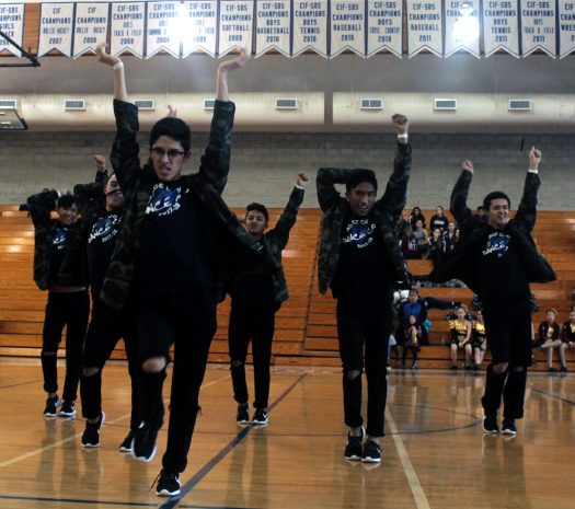 Marcos Loaiza, 11, leads Dance-Co in a formation at competition.