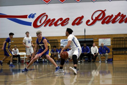 One on one Andres Tovar, 12, goes against Grossmont's number five .