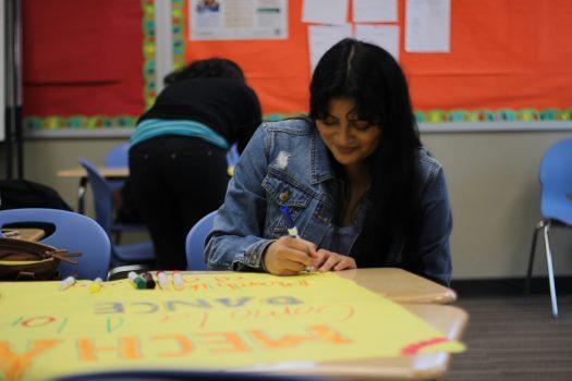 Alejandra Martinez, 12, creates a poster promoting the MEChA dance.